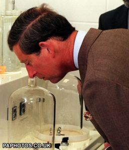 THE PRINCE OF WALES CONDUCTS A SNIFF TEST ON UNTREATED WATER DURING HIS VISIT TO ENNERDALE IN THE LAKE DISTRICT, WHERE HE OPENED A TREATMENT WORKS.