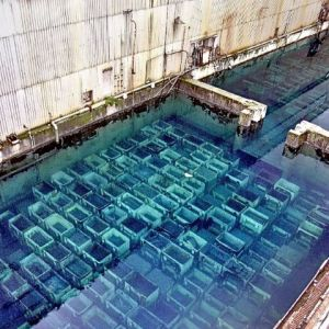 The B30 pond showing a full loading with fuel rods and radioactive debris