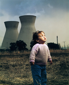 Beyond Nuclear girl in front of nuclear reactors