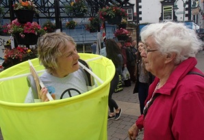 Jean Ward (Lady in Red) chatting to a nuclear waste barrel at #StopMoorside demo